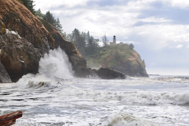 Waves splashing against rocks at Cape Disappointment lighthouse